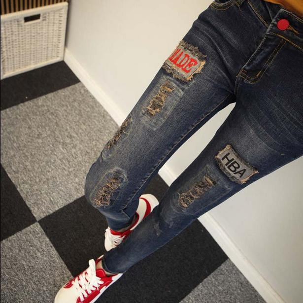 2017 New frayed hole jeans pants Korean female feet Slim was thin pencil pants stick drill