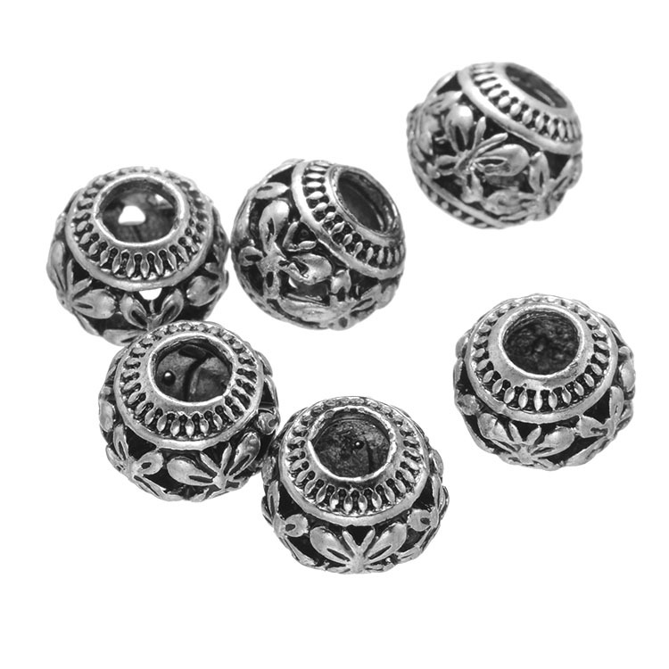 The butterfly pattern alloy large hole beads Hollow out the big hole beads scattered beads wholesale restoring ancient ways