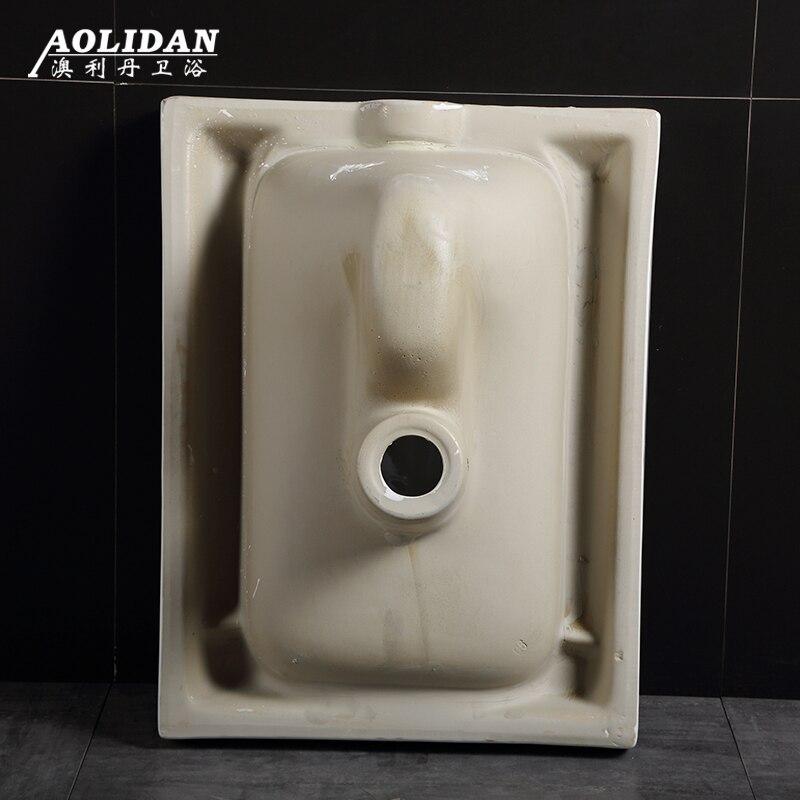 Ceramic Deodorizing Squatting Toilet 1