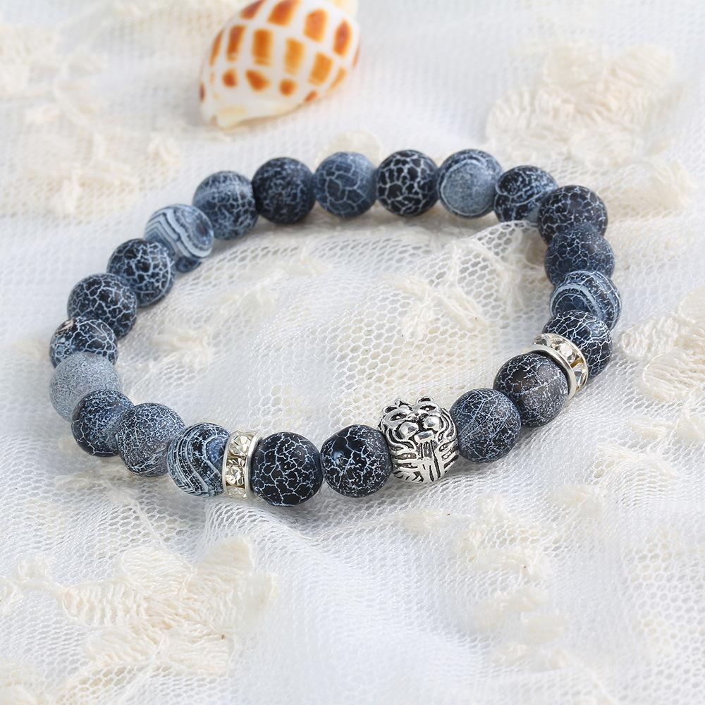 8bbcd847c1 US $1.39 30% OFF|Lion King Design Tiger Eye Stone Mens Beaded Bracelets  With Crystal Rivet Black White Beads Strand Bracelet Male Jewelry-in Strand  ...