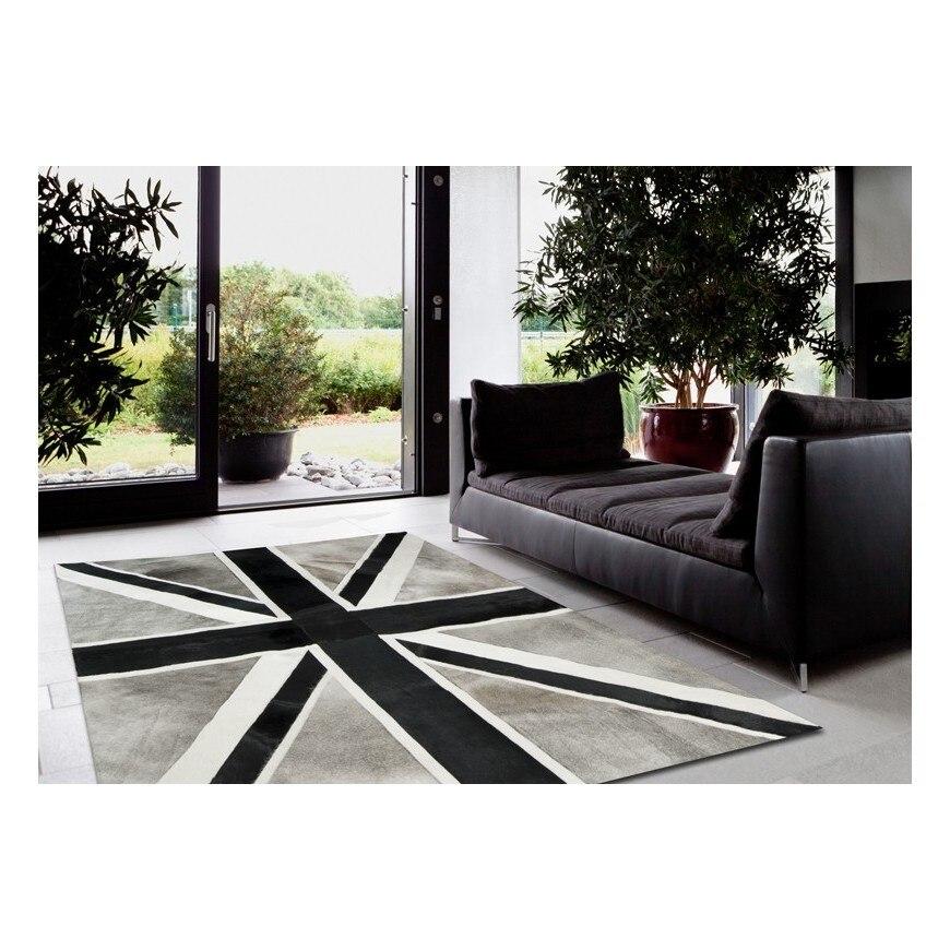 Tapis patchwork en peau de vache classique tapis en fourrure de vache arborant le drapeau Union Jack dans un design monochrome noir/gris