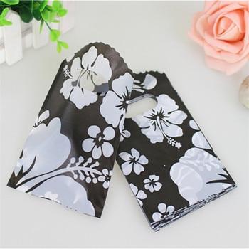 Venta caliente nuevo diseño al por mayor 50 unids/lote 9*15cm alta calidad pequeña bolsa de plástico con flores Mini bolsas de joyería