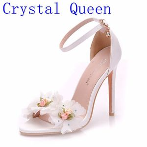 Image 1 - Crystal Queen Sweet white Flower Sexy Dress Wedding Shoes Women Lacing Ankle Strap Peep Toe High Heels Sandals Floral Shoes