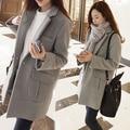 Mulher casaco de 2015 Outono e Inverno Estilo Longo Com Decote Em V Da Faculdade vento Sólidos Único Botão Bolso do Casaco De Lã Das Mulheres Plus Size panos