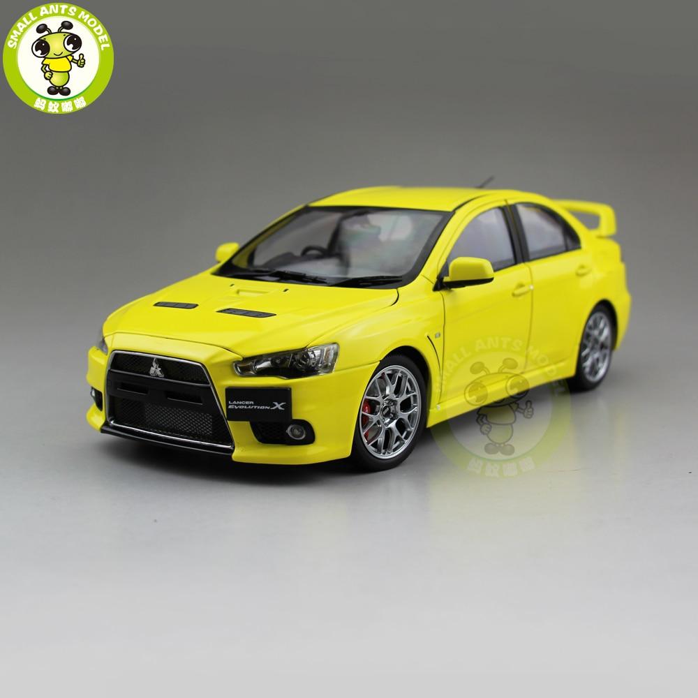 купить 1/18 Mitsubishi Lancer EVO X 10 EVO-X Right Steering Wheel Metal Diecast Car Model Toy Girl Boy Gift Yellow Color по цене 4858.99 рублей