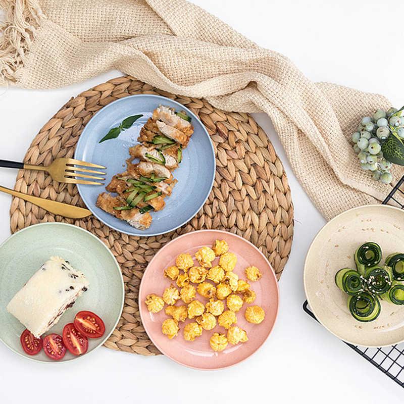เมล็ดแตงโมแผ่นฟางข้าวสาลีสแน็คแผ่นเป็นมิตรกับสิ่งแวดล้อมรอบจานขนมหวานตกแต่งจานอาหารเย็น