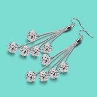 Leuke vrouwelijke 925 sterling zilveren oorbellen holle bal hanger ontwerp zilveren oorbellen meisje populaire sieraden verjaardagscadeau