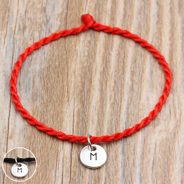 Bracelet couple initial rouge cordon tibétain