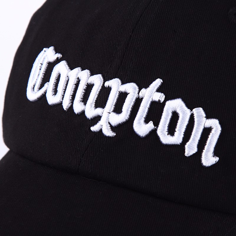 """Embroidered """"Compton"""" Adjustable Baseball Cap - Closeup of White Letter Embroidery"""