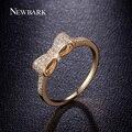 Newbark clássico minimalista anel encantador bonito arco nó anéis empilháveis branco E Banhado A Ouro Minúsculo CZ Pavimentada Para As Mulheres Pequenas anel