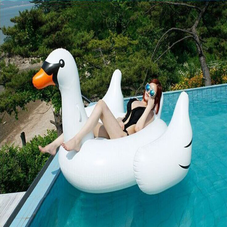 ФОТО Large inflatable flamingos white swan Ms water inflatable mounts water floating row floating bed swim ring