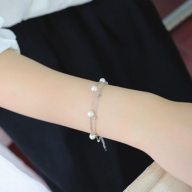 женский браслет с искусственным жемчугом из нержавеющей стали фотография