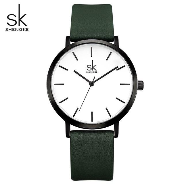 Shengke ファッション女性のクォーツ時計女性クリエイティブストラップ色を変更時計アナログレディースドレスジュネーブ腕時計リロイ Mujer