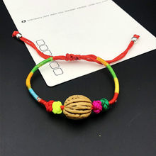 1pcs sell Baby The Newborn Strand Bracelets The Dog Tooth Peach Pit Bracelets The Bell Red Rope Hand Catenary(China)