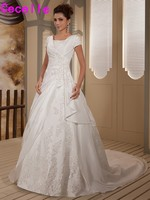 2017 Real Designer Modest Ball Gown Wedding Dresses Bridal Gowns With Sleeves Appliques Beaded Taffeta Chaple