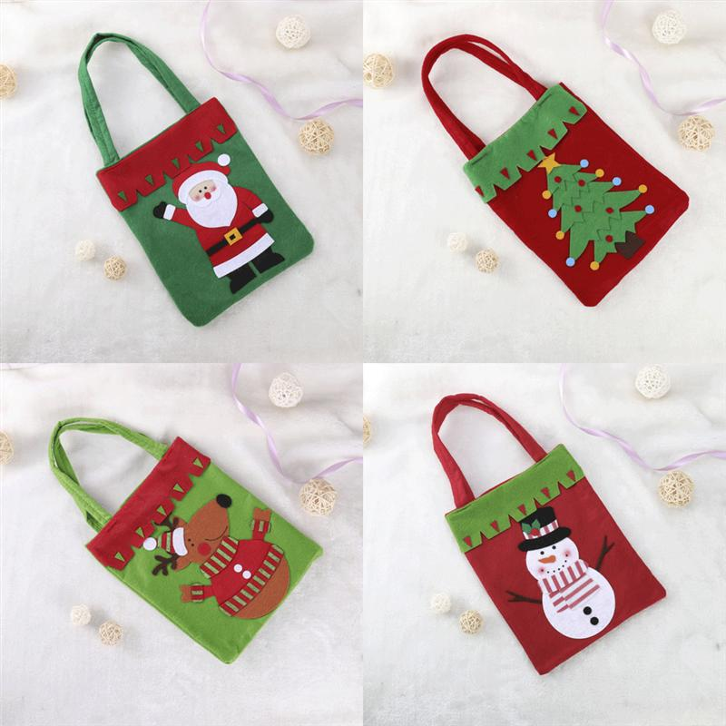 Christmas Gift Bags Non woven Fabric Santa Claus Snowman Deer Xmas Tree  Candy Sweet Treat Handy Bags for Christmas Decorations-in Stockings   Gift  Holders ... fd0aaa96da06b