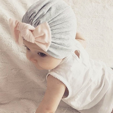 a61dfef1957 Bowknot Baby Turban Hats Newborn Girl Toddler 18 24M Spring   Solid Cotton Infant  Baby Beanie