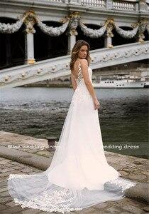 Image 4 - Profundo decote em v corpete duplo em camadas sereia vestido de casamento com trem destacável ilusão tatuagem estilo voltar vestido de noiva