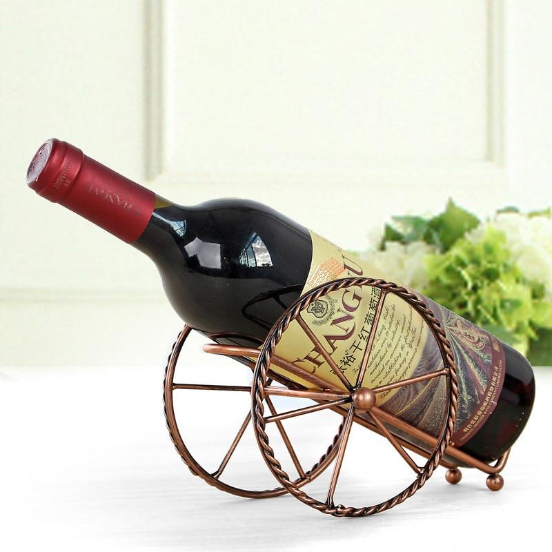 Estante de vino tinto de metal de estilo europeo Ruedas de hierro de bronce Diseño Soporte de vino Home Bar Decoración Estante de exhibición Botellas de vino de cerveza Whisky