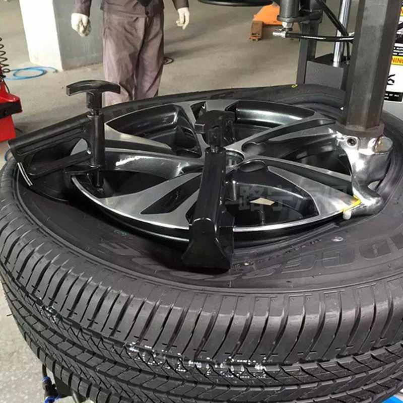 חדש באיכות גבוהה 1 Pc אוטומטי רכב צמיג מחליף חרוז קלאמפ זרוק מרכז כלי אוניברסלי שפת לחטט גלגל שינוי עוזר