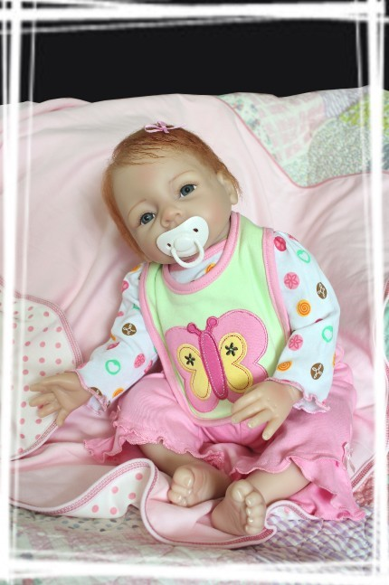 Здесь можно купить  22inch 55cm Magnetic Mouth Reborn Baby Doll Soft Silicone Lifelike Toy Gift for Children Christmas Present Butterfly Pink  Игрушки и Хобби