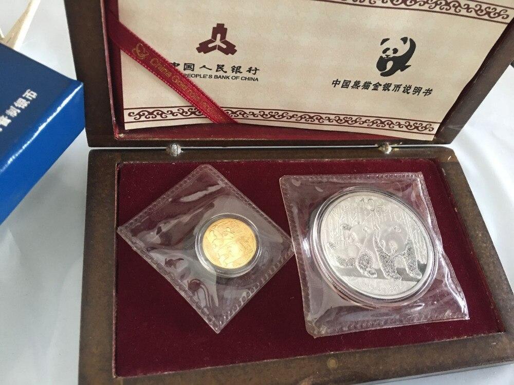 Pièce plaquée argent panda de chine de 2010 ans de seconde main 1 oz et pièce plaquée or 1/10 oz avec boîte et copie de certificat