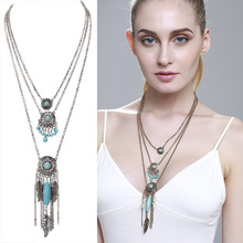 цены The new European folk style retro Turquoise feathers multi alloy long sweater chain necklace tassel accessories