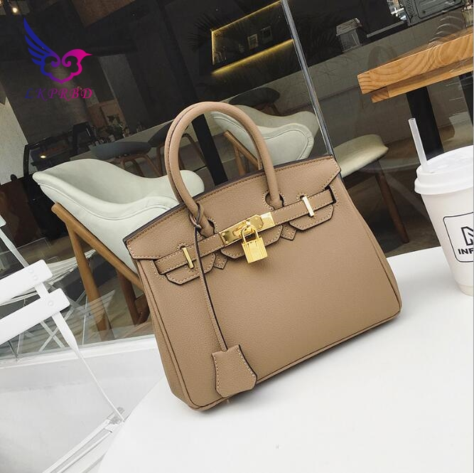 Leather handbags female tide Europe and the United States big fashion lychee pattern handbag shoulder diagonal large package europe and the united states style first layer of leather lychee handbag fashion retro large capacity solid business travel bus