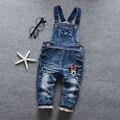 Bebés del otoño del resorte azul denim jeans monos de dibujos animados niño niña pantalones del babero
