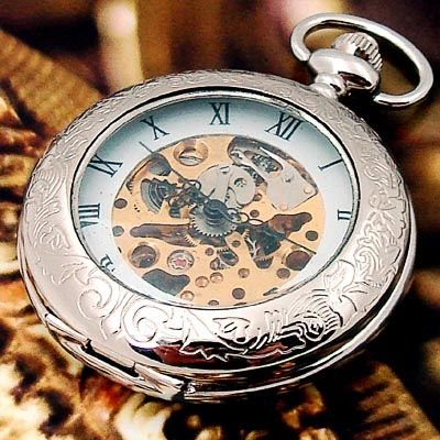 white mechanical skeleton pocket watch w carved pattern in pocket