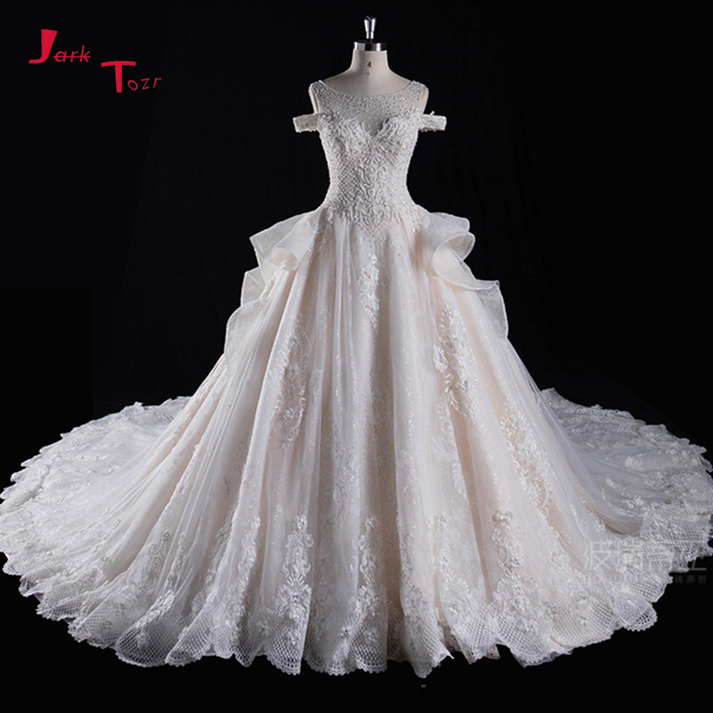 Joky Quaon New Arrive Super Gorgeous Wedding Dresses Robe De Mariee Full Beading Pearls Bodice Chapel Train Bow Bridal Gown 2019