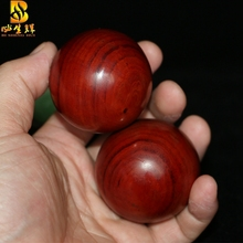 health care ball rosewood rosewood handball hand pieces playing pieces of wood ball wooden hands grip the ball player