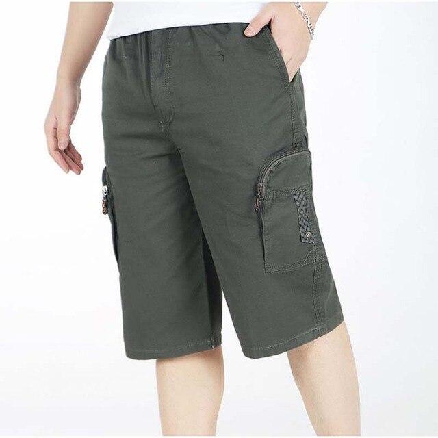 miglior sito web c88cc f4d9a US $21.74 10% di SCONTO|Più grande formato ritagliata pantaloni larghi da  uomo casual pantaloni a vita alta elastica polpaccio lunghezza pantaloni ...