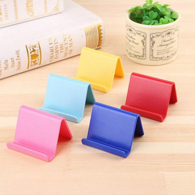 Willekeurige kleur mini draagbare visitekaartje houder mobiele telefoon houder mobiele telefoon houder vaste houder huishoudelijke goederen plastic