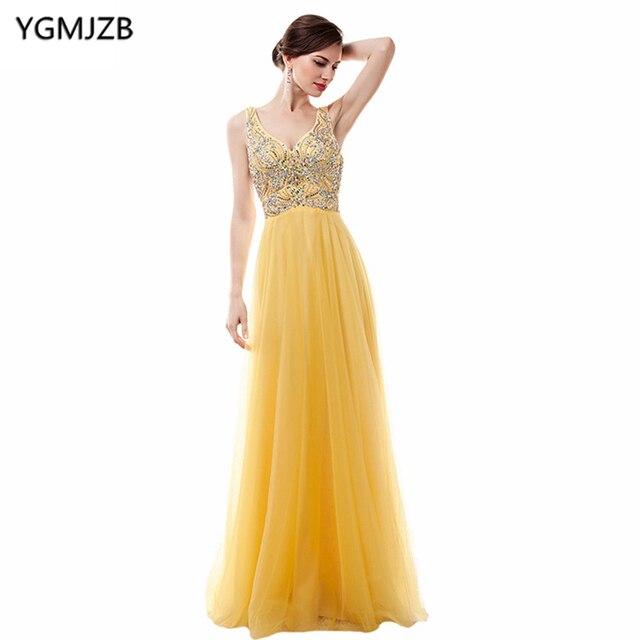 ded7e06929f29 Vestidos largos amarillos de noche 2018 Línea A cuello pico Spaghetti Strap  lentejuelas con cuentas chifón