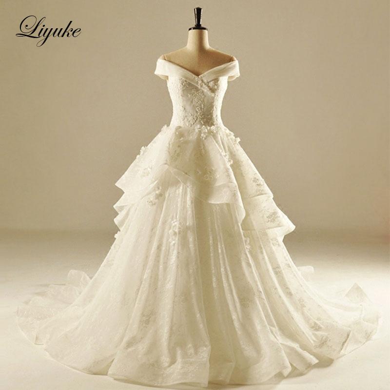 Lustrous Tulle Sweetheart Halsband Beading A-Line Bröllopsklänning Med Chapel Train Appliques Lyx Bröllopsklänning