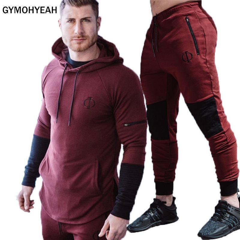 bfd6418b62aa GYMOHYEAH männer anzug sportswear jogger fitness anzug männer der  turnhallen Trainingsanzüge männer Bodybuilding Hoodies + Hosen