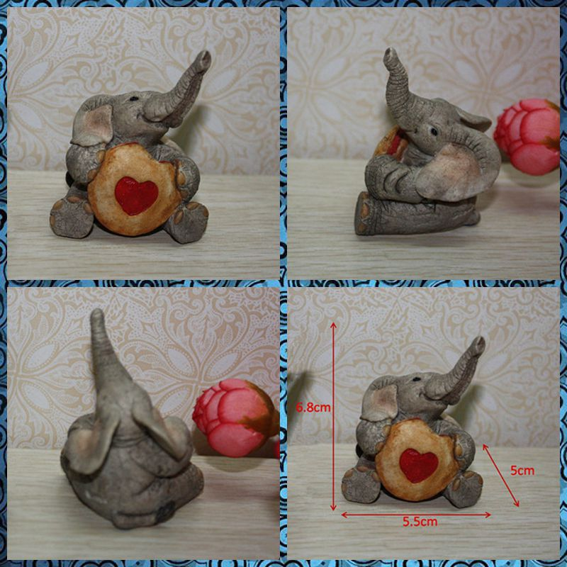 Free shipping 1PC Baby Elephant Holding Heart Figure Resin toy vivid lifelike animal cake home office car decoration party gifts
