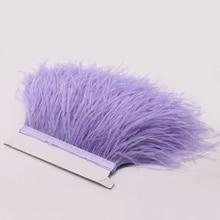 La venta caliente teñió el cuero púrpura claro de la avestruz empluma los ajustes de la franja de la pluma del plumaje natural para el vestido del traje