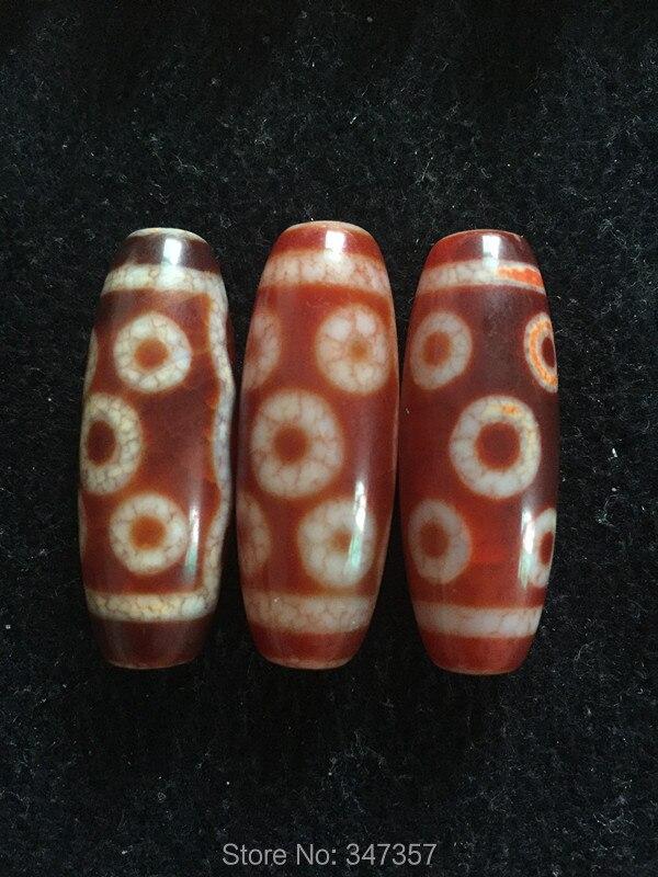 цены на Fengshui Ji Beads 14mm*40mm DYI Tibetan 8 Eyes Mystical Natural Stone Heaven Eyed Dzi Red Color Great Charm Accesorries в интернет-магазинах