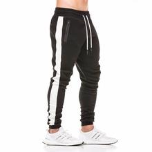 2018 jesień nowe męskie bawełniane spodnie dresowe Siłownie Fitness trening solidne Spodnie męskie Casual Fashion ołówek spodnie joggers Sportswear tanie tanio Mężczyzn Pełna długość Połowie Herringbone Łączonej Płaskie Sznurkiem Spandex bawełna Z BRZK Midweight YF-1456