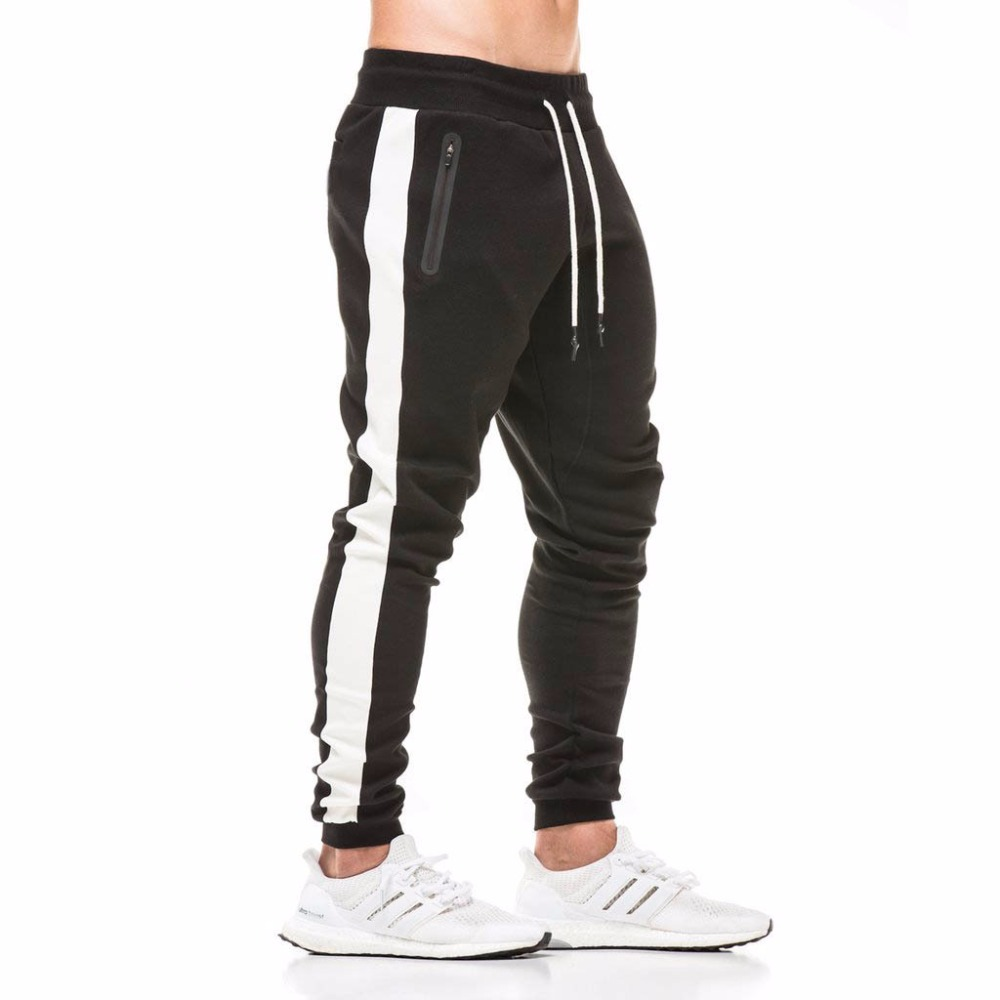 2018 otoño nuevo para hombre de algodón pantalones de chándal gimnasios Fitness entrenamiento sólido pantalones de hombre de moda Casual pantalones lápiz pantalón ropa deportiva