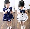 Niños vestidos para niñas 2016 nuevo verano del bebé vestido de estilo marinero para las niñas niños solapa del algodón del vestido Navy con pajarita grande