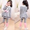 Frete grátis!! 2014 primavera novo conjunto de roupas crianças das crianças Coreanas bonito orelhas de coelho meninas conjunto terno e moda quente e macia