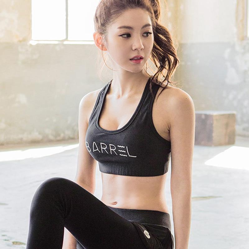 99dde9127f RealLion Body Building Sports Bra Chest Pad Springy Girls Bras Yoga T shirt  Women Clothing Bikini Push Up Fitness-in Sports Bras from Sports    Entertainment ...