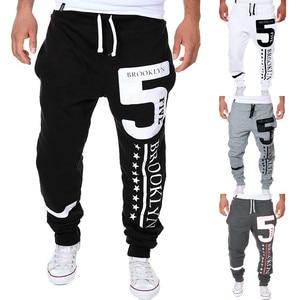 Men's Sweatpants 2019 Fashion  printing casual Personal solid color loose Elastic Waist Mid trousers jogging nine pants 3.22