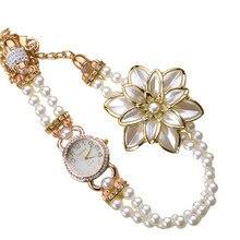Important Sizzling relogio feminino Clock Quartz Luxurious Pearl Strap White Flower Bracelet Quartz Wristwatches Girls DressWatch feb17