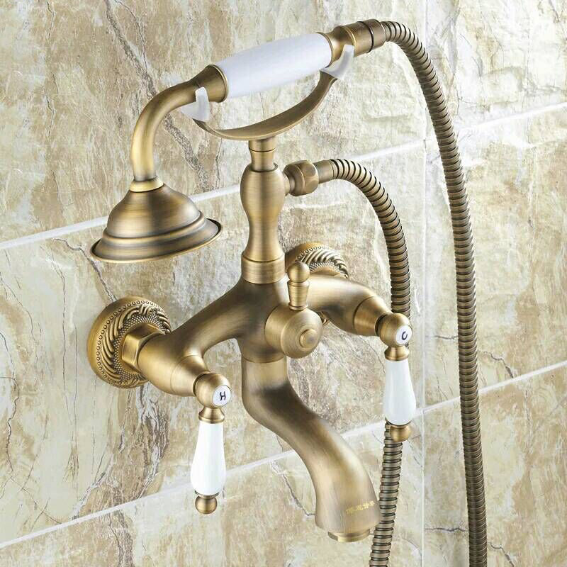 Free Shipping Wholesale And Retail Stylish Antique Brass Deck Mounted Bathtub Faucet Dual Handles Mixer Tap With Hand Shower