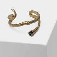 Snake with black beads in its mouth designed retro bangles