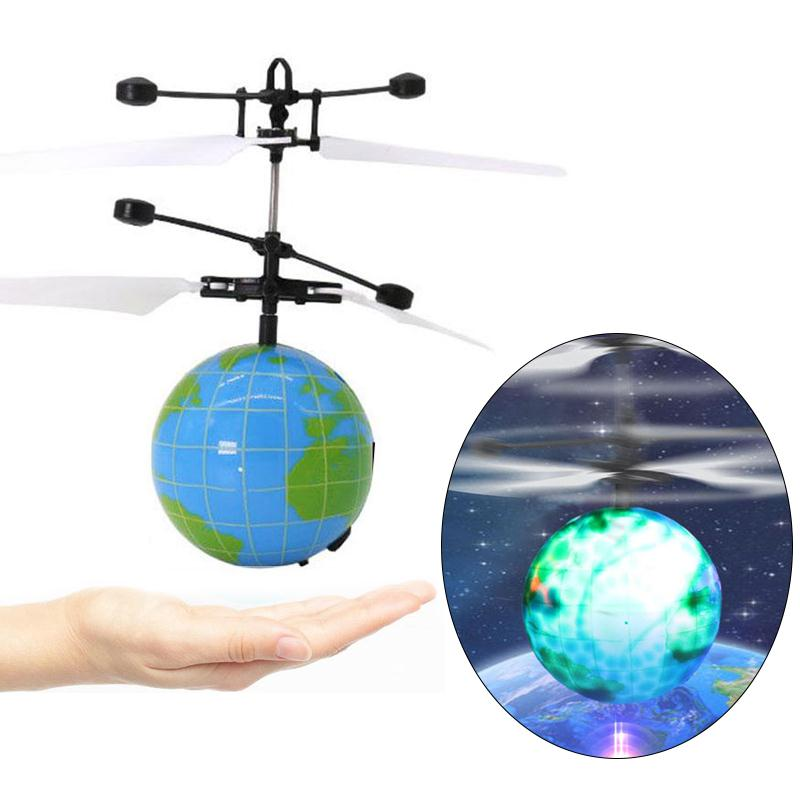 купить 1Pc Luminous Flying Ball Hand Induction Intelligent Earth Drone Aircraft Light Mini RC Heli Ball Funny Gadgets Outdoor Toys по цене 333.19 рублей